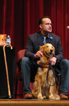 "Former U.S. Army Captain Luis Carlos Montalvan, author of ""Until Tuesday: A Wounded Warrior and the Golden Retriever Who Saved Him"" and his service dog, Tuesday, visit CCC as part of the One Book-One College reading program."