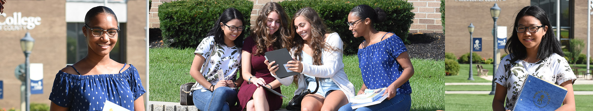 Students looking at an iPad on campus