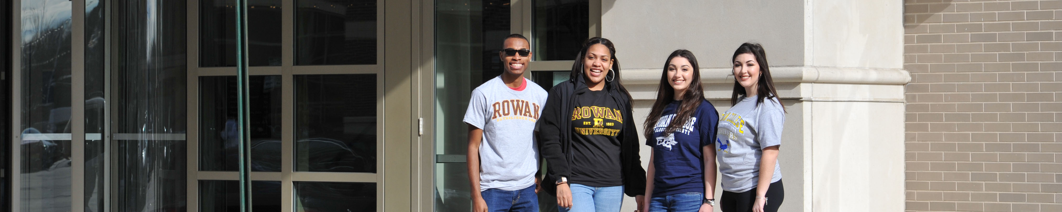 Students with RCSJ t-shirts along with Students with Rowan University standing outside